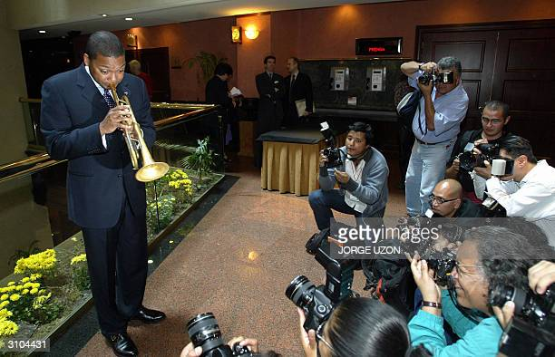 World famous US trumpet player Wynton Marsalis plays for the journalists prior to a press conference 17 March 2004 in Mexico City Marsalis is in...