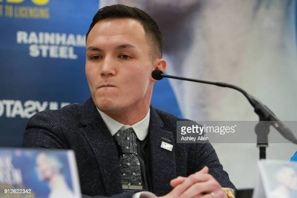 World Featherweight boxer Josh Warrington listens to his challenger IBF World Featherweight Champion Lee Selby during the press conference in the...