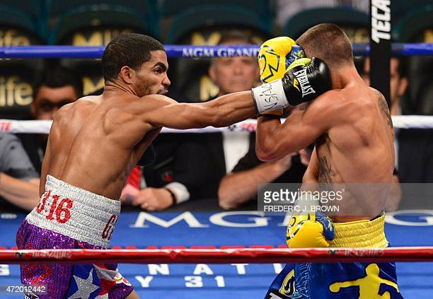 World featherweight boxing champion Vasyl Lomachenko of Ukraine absorbs a right from Gamalier Rodriguez of Puerto Rico on May 2 2015 at the MGM Grand...