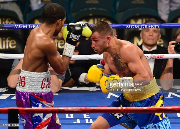 World featherweight boxing champion Vasyl Lomachenko of Ukraine goes on the offensive against Gamalier Rodriguez of Puerto Rico on May 2 2015 at the...