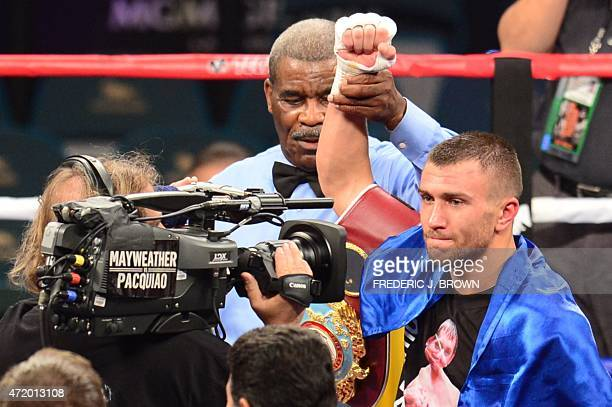 World featherweight boxing champion Vasyl Lomachenko of Ukraine celebrates his ninth round knocout victory over Gamalier Rodriguez of Puerto Rico on...