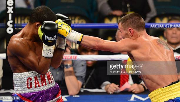 World featherweight boxing champion Vasyl Lomachenko of Ukraine connects against Gamalier Rodriguez of Puerto Rico on May 2 2015 at the MGM Grand...