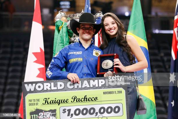 World Finals Champion Kaique Pacheco poses with his girlfriend Juliana Antonio following the final round of the Professional Bull Riders World Finals...
