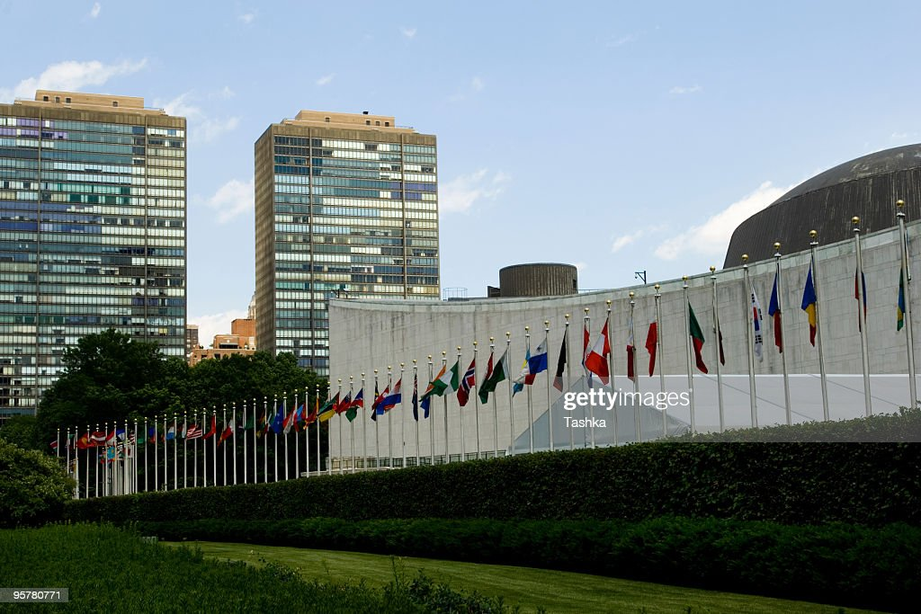 World flags in front of the United Nations building : Stock Photo