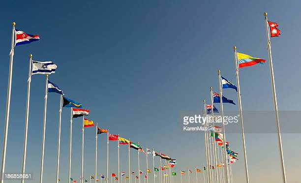 World flags on display bellow the blue sky