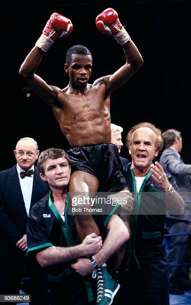 IBF World flyweight champion Duke McKenzie is carried by his manager Mickey Duff and trainer Colin Smith after he had retained his title with victory...
