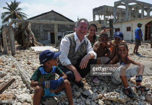 UN World Food Program Executive Director David M Beasley poses for a photo with children while visiting the Jaimanitas neighborhood of Havana that...