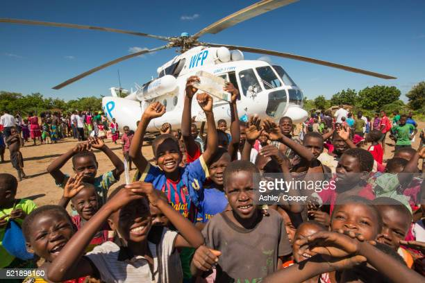 a world food program relief flight for victims of the devastating 2015 malawi floods. - humanitarian aid stock pictures, royalty-free photos & images