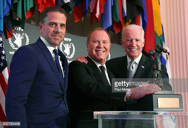 World Food Program USA Board Chairman Hunter Biden and US Vice President Joe Biden award designer Michael Kors the World Food Program USA's...