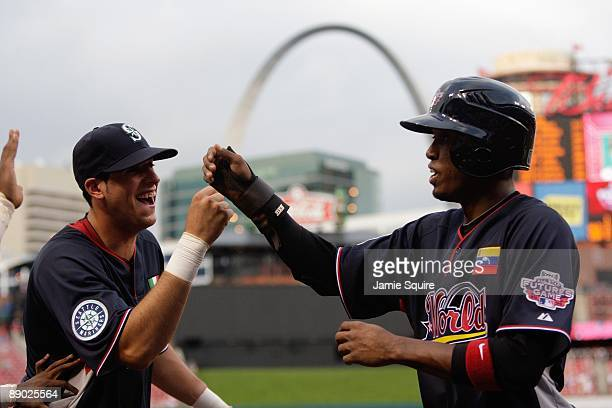 World Futures AllStar Alex Liddi of the Seattle Mariners congratulates Alcides Escobar of the Milwaukee Brewers for his home run during the 2009 XM...