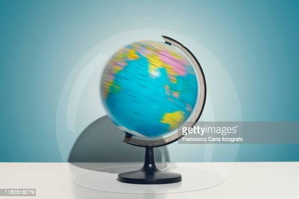 world globe in a bubble - mappamondo foto e immagini stock