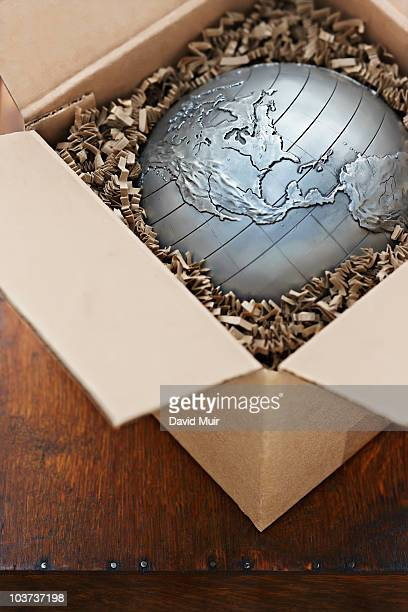world globe in a shipping box showing the Americas