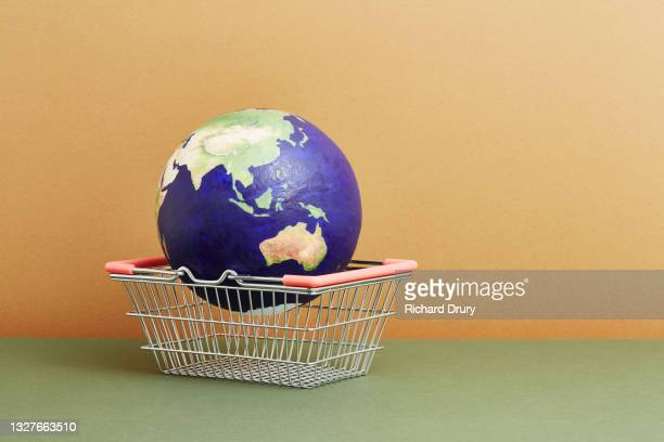 a world globe in a shopping basket - global stock pictures, royalty-free photos & images