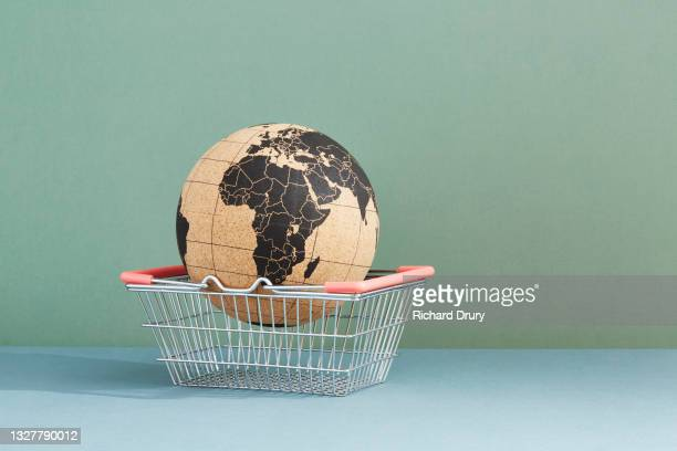 a world globe in a shopping basket - richard drury stock pictures, royalty-free photos & images