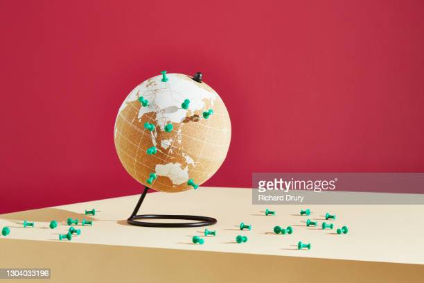 a world globe marked with push pins - richard drury stock pictures, royalty-free photos & images