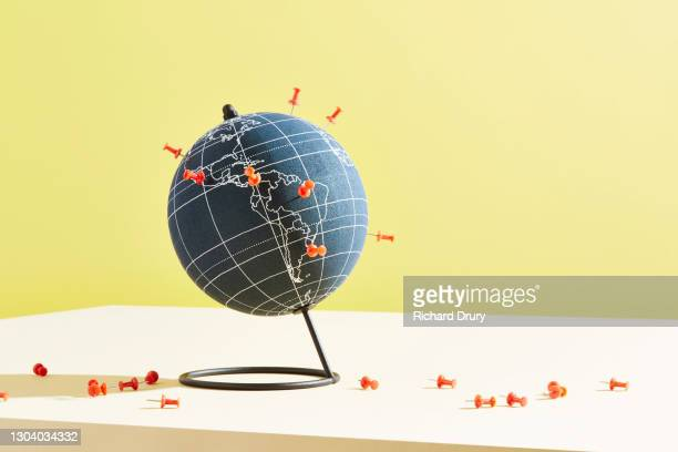 a world globe marked with push pins - politics and government stock pictures, royalty-free photos & images