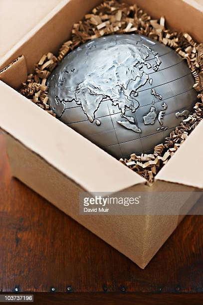 world globe on a shipping box showing Asia