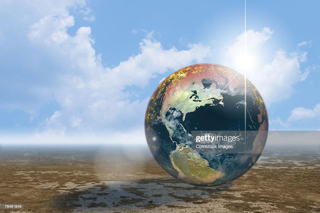 World globe on deserted plain : Stock Photo