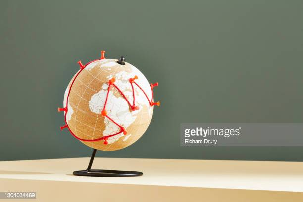 a world globe with a journey marked in red string and pins - richard drury stock pictures, royalty-free photos & images