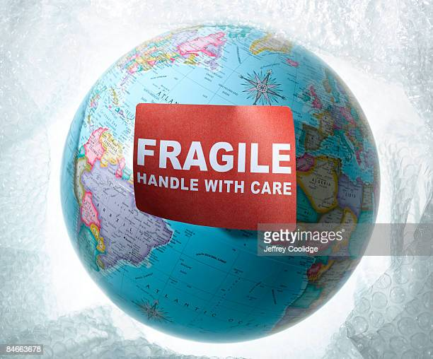 world globe with fragile sticker - fragile sticker stock pictures, royalty-free photos & images