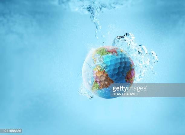 World golf ball in water
