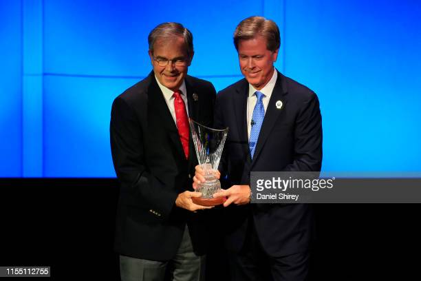 World Golf Hall of Fame inductee Billy Payne recieves the Induction Crystal from Fred Ridley Chairman of Augusta National Golf Club during the 2019...