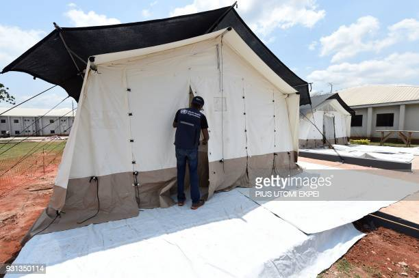 A World Health Organisation closes a tent erected by the Alliance for International Medical Action for patients infected with Lassa fever at the...