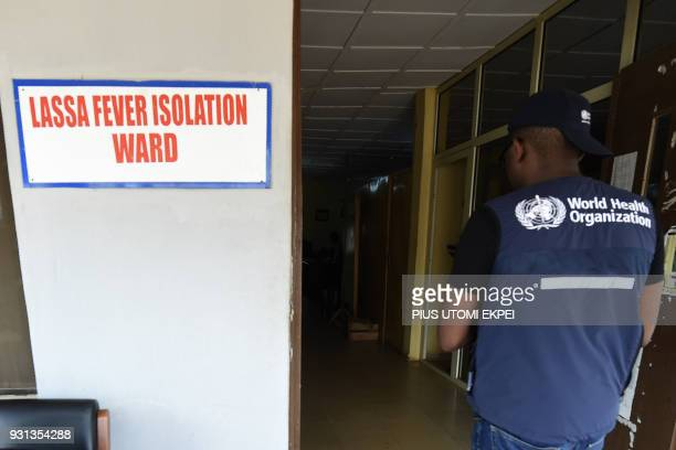 A World Health Organisation official arrives at the Lassa fever isolation ward at the Institute of Lassa Fever Research and Control in Irrua...