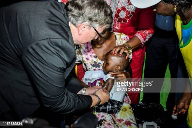 World Health Organisation representative to Kenya Dr. Ruddi Eggers vaccinates a child in Ndhiwa, Homabay County, western Kenya on September 13, 2019...