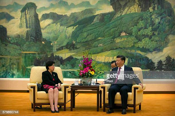 World Health Organization DirectorGeneral Margaret Chan and Chinese President Xi Jinping right speak during a meeting at the Great Hall of the People...