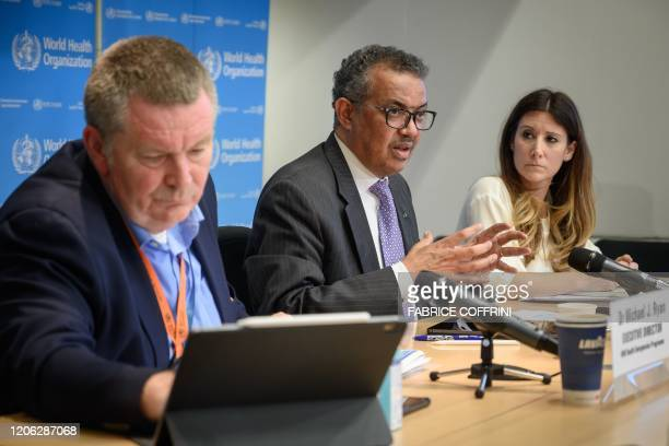 World Health Organization DirectorGeneral Tedros Adhanom Ghebreyesus speaks past WHO Health Emergencies Programme Director Michael Ryan and WHO...