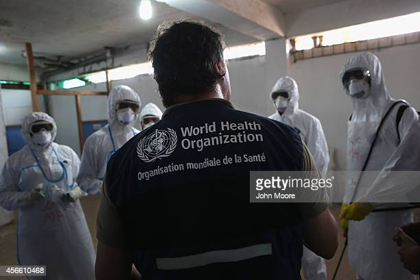 World Health Organization instructor teaches new health workers during a training session on October 3 2014 in Monrovia Liberia The WHO is training...