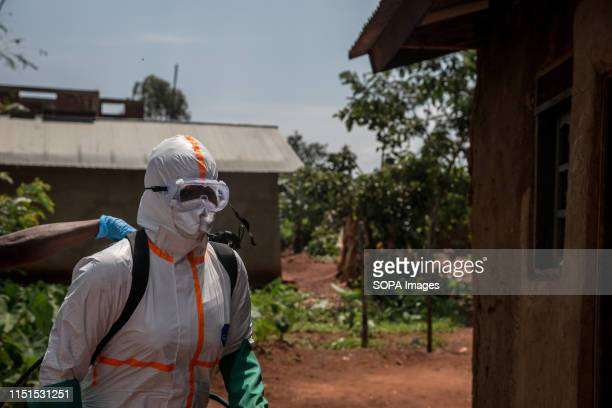 World Health Organization worker Belinda Landu decontaminates the house of a pastor who has just tested positive for Ebola in Beni The DRC is...