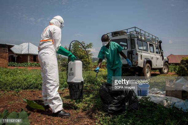 World Health Organization workers decontaminate the house of a pastor who has just tested positive for Ebola in Beni The DRC is currently...
