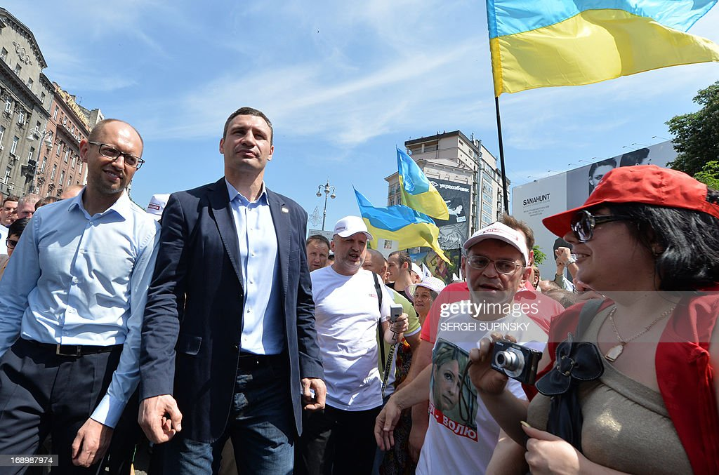 World Heavy Weight Boxing Champion and one of the leaders of Ukrainian opposition Vitaly Klitschko (2nd L) takes part in an opposition rally 'Rise up Ukraine!' in the center of Kiev on May 18, 2013. Protestors demanded to free jailed former Ukrainian prime minister and leader of the opposition Yulia Tymoshenko and others political prisoners.