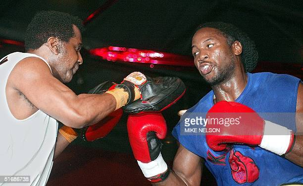 World heavyweight boxing champion Lennox Lewis of Britain spars with trainer Emmanuel Steward at the Sam's Town Casino 05 June 2002 in Tunica...