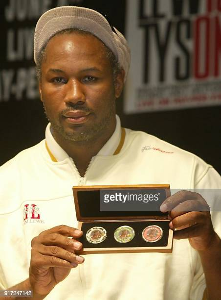 World heavyweight boxing champion Lennox Lewis shows a set of gambling chips with his likeness during a press conference at Sam's Town Casino in...