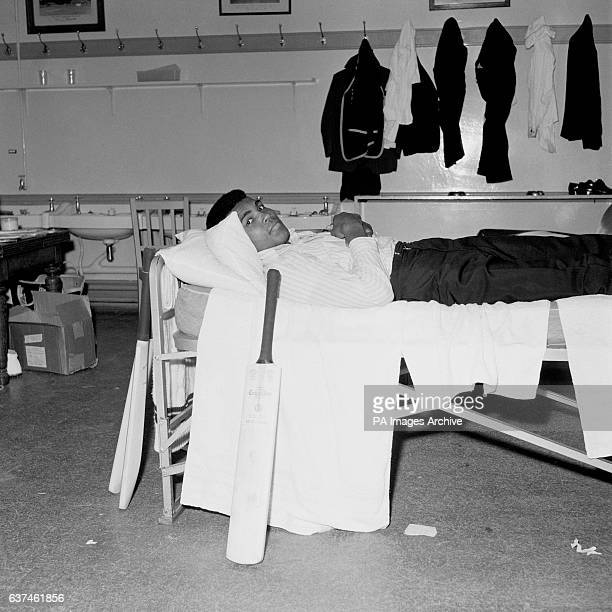World Heavyweight Boxing Champion Muhammad Ali has a rest in the West Indies dressing room