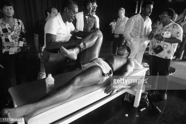 MANILA SEPTEMBER 01 World heavyweight boxing champion Muhammad Ali is massaged by his masseur after training session in the gym days before his bout...