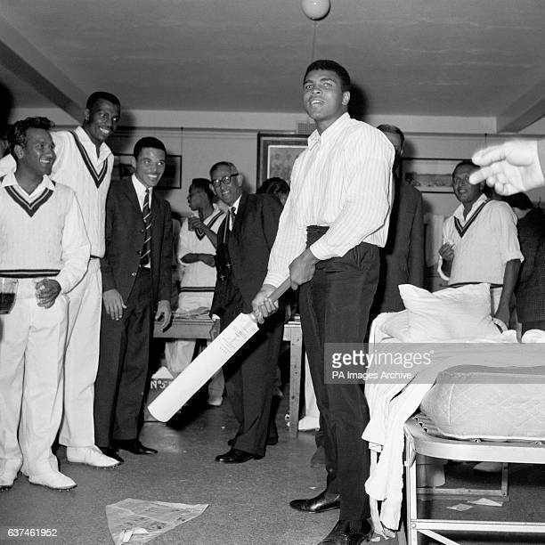 World Heavyweight Boxing Champion Muhammad Ali practises his batting technique in the West Indies dressing room to the amusemement of the West Indies...