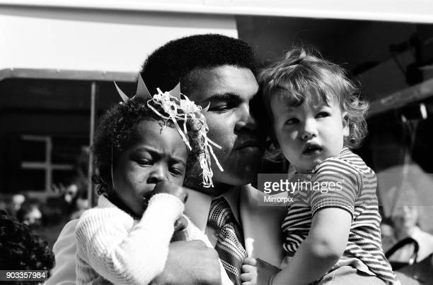 World heavyweight boxing champion Muhammad Ali presented a sunshine coach on the behalf of the Variety club of Great Britain the children's charity...