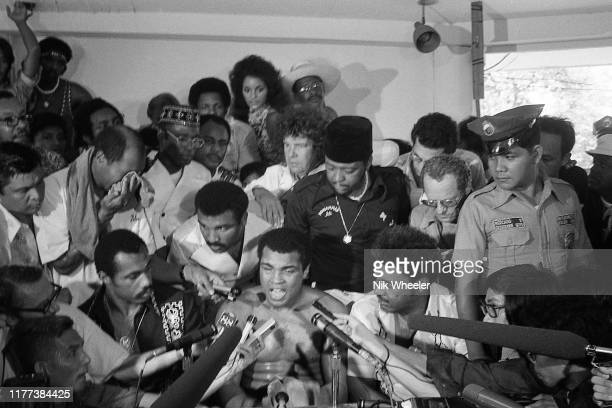 World Heavyweight boxing champion Muhammad Ali speaks to the international press during break in training in gym days before his heavyweight bout...