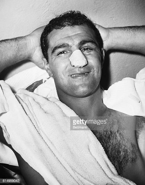 World heavyweight boxng championship Rocky Marciano relaxes in his dressing room at Yankee Stadium here following his title bout with challenger...