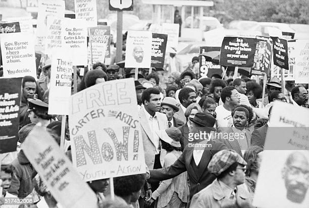 World heavyweight champ Muhammad Ali leads a rally of some 1000 persons through streets of Trenton here to urge New Jersey Governor Brendan Byrne to...