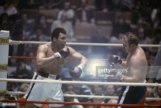 World heavyweight champion boxer Muhammad Ali follows through on a punch towards challenger Chuck Wepner during a heavyweight title fight on March 24...
