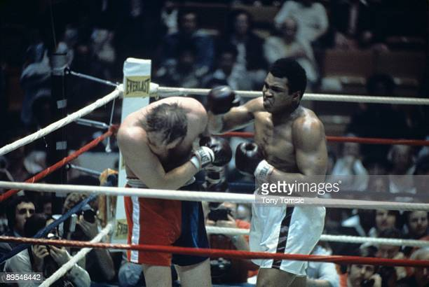 World heavyweight champion boxer Muhammad Ali lands a right hand to the side of the head of challenger Chuck Wepner during a heavyweight title fight...