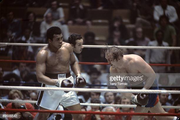 World heavyweight champion boxer Muhammad Ali steps back from a punch by challenger Chuck Wepner during a heavyweight title fight on March 24 1975 at...