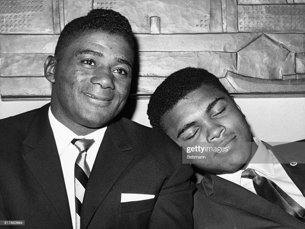World heavyweight champion Cassius Clay, later known as Muhammad Ali, naps on the shoulder of former champion Floyd Patterson during a press conference at which Clay announced that he agreed to defend his title against former champion Patterson.