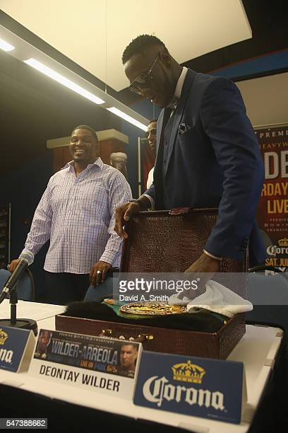 World Heavyweight Champion Deontay Wilder polishes his title belt during a press conference at the BirminghamJefferson Civic Center on July 14 2016...