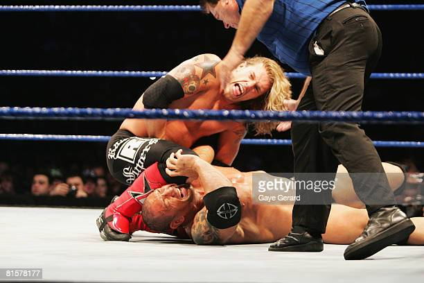 World Heavyweight Champion Edge puts a knee to the head of Batista during WWE Smackdown at Acer Arena on June 15 2008 in Sydney Australia